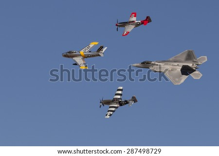 HILLSBORO, OR - SEPT 21: P-51 Mustang WW II, F-86F Sabre and USAF F-22 Raptor aircrafts perform heritage flight during Oregon International Air Show on September 21, 2014 in Hillsboro, OR.