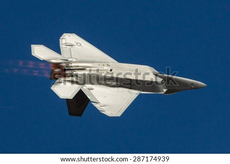 HILLSBORO, OR - SEPT 20: USAF F-22 Raptor aircraft demonstration during  Oregon International Air Show at Hillsboro Airport on September 20, 2014 in Hillsboro, OR.  - stock photo