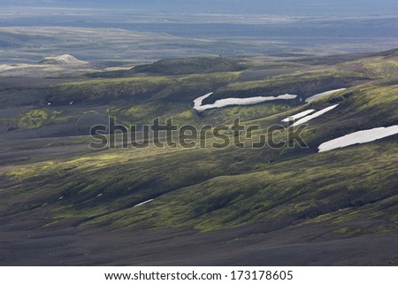 Hillside covered with moss, snow and volcanic ash, Lakagigar area, Iceland - stock photo
