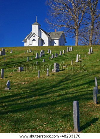 hilltop church and cemetery - stock photo