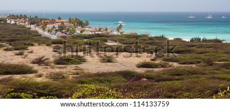 hilltop view of caribbean coastline - stock photo
