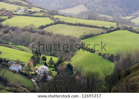 Hilly countryside with green fields