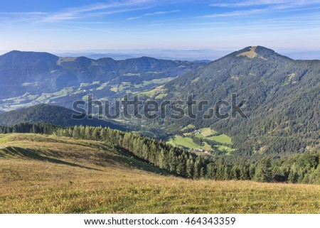 Hilly landscape with mountain pasture in foreground, Slovenia