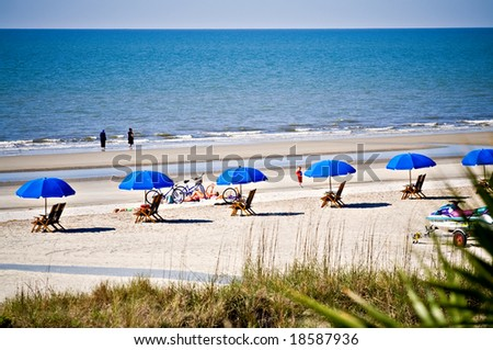 Hilton Head Island, South Carolina beach landscape - rental umbrellas, bikes and chairs. - stock photo