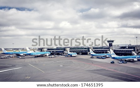 HILVERSUM, NETHERLANDS - FEBRUARY 03, 2014: Amsterdam Airport Schiphol is the main international airport of the Netherlands. It is the fourth busiest airport in Europe in terms of passengers. - stock photo
