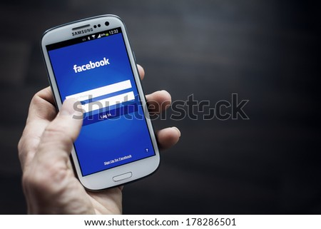 HILVERSUM, NETHERLANDS - FEBRUARY 23, 2014: Facebook is an online social networking service founded in February 2004 by Mark Zuckerberg with his college roommates and is now a fortune 500 company. - stock photo
