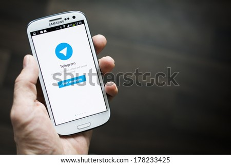 HILVERSUM, NETHERLANDS - FEBRUARY 23, 2014: Telegram Messenger is a free and partially open source cross-platform messenger with a focus on security founded in 2013 by brothers Nikolai and Pavel Durov - stock photo