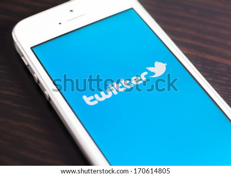 "HILVERSUM, NETHERLANDS - JANUARY 08, 2014: Twitter is an online social networking and microblogging service that enables users to send and read ""tweets"", limited to 140 characters. - stock photo"