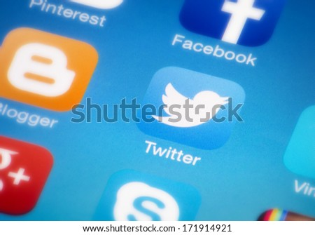 "HILVERSUM, NETHERLANDS - JANUARY 18, 2014: Twitter is an online social networking/microblogging service that enables users to send and read ""tweets"", which are text messages limited to 140 characters. - stock photo"