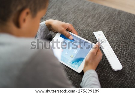HILVERSUM, NETHERLANDS - May 03, 2015: More than half of children use social media by the age of 10. 43 per cent had messaged strangers, starting from an average age of 12 - stock photo