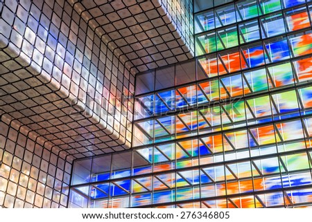 HILVERSUM, THE NETHERLANDS - MARCH 03: Modern interior Dutch institute Sound and Vision with huge colorful glass wall on March 03, 2015 in Hilversum, The Netherlands - stock photo