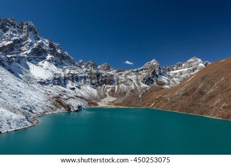 Himalaya Mountain landscape. View over Gokyo Lake, Sagarmatha National Park, Nepal. Amazing turquoise color mountain lake under the deep blue sky on a bright sunny day. - stock photo