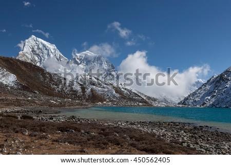 Himalaya Mountain landscape. View over Gokyo Lake, Sagarmatha National Park, Nepal. Beautiful turquoise color mountain lake under the deep blue sky on a bright sunny day. - stock photo