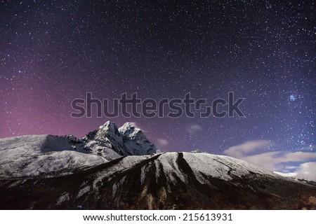 himalaya mountain with star in night time - stock photo
