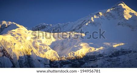 himalaya mountain with star in sunrise time - stock photo