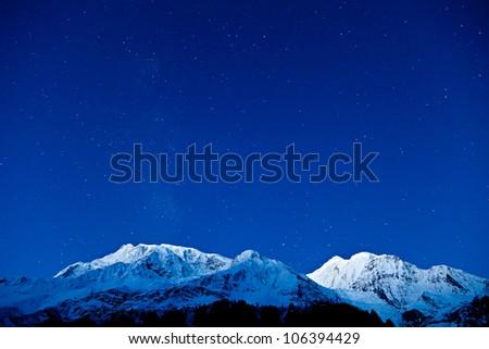 Himalaya mountains on the blue sky with stars, Himalaya, Nepal - stock photo