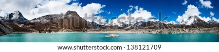 Himalaya panorama: sacred lake near Gokyo and Everest summit in the right part of the image. Travel to Nepal - stock photo