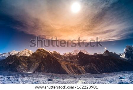 Himalaya scenic mountain landscape against the sunset sky - stock photo