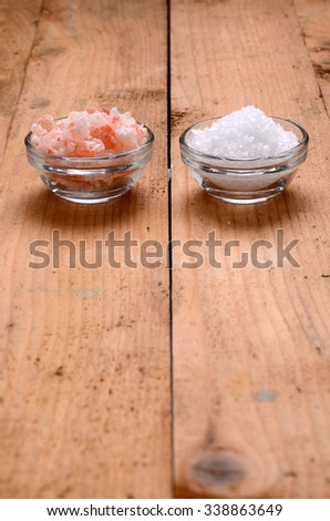 Himalayan pink salt, and sea salt on a wooden table