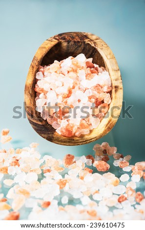 himalayan pink salt on a olive wood spoon - stock photo
