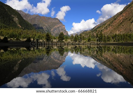 Himalayas and clouds reflection, Annapurna trek, Nepal