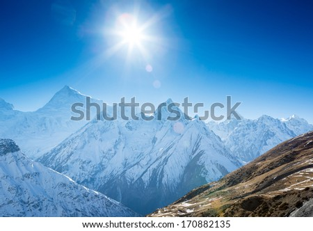 Himalayas mountains in sunlight  - stock photo