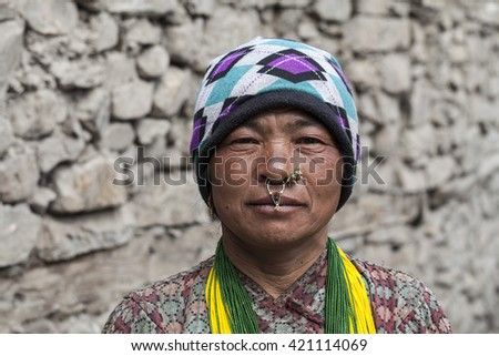 HIMALAYAS, NEPAL - MAY 10, 2014: A portrait of an undefined Nepali woman in mountain village in Annapurna region in Himalayas, Nepal