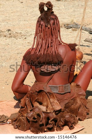 Himba woman with traditional cultural decorations, Kaokoland, Namibia - stock photo