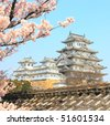 Himeji Castle and spring cherry blossoms - stock photo