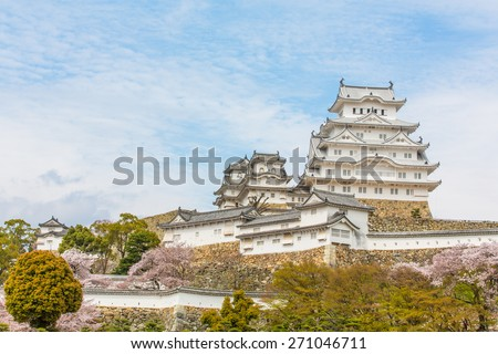 himeji castle renew 2015 surrounded by cherry blossom - stock photo