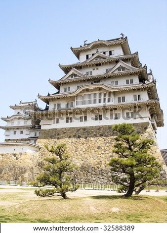 Himeji Castle with trees - stock photo