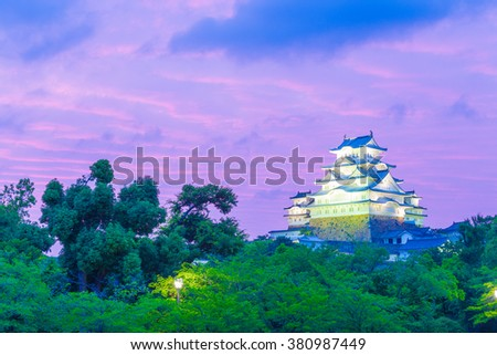 Himeji-jo castle during a colorful purple sky sunset in a typical summer evening in Himeji, Japan after 2015 renovations finished. Horizontal copy space - stock photo