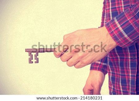 Hindu cool young man opening with a key - stock photo