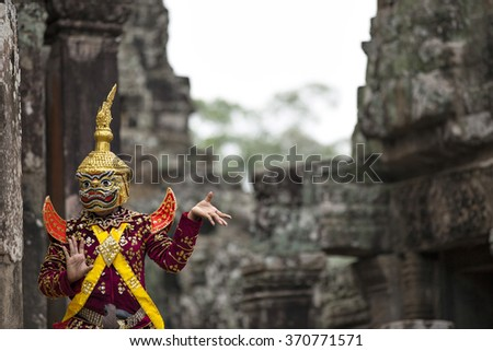 Hindu cultural legend of deity with hands gestures reenacting by an actor in colorful costume at Bayon temple ruins, Angkor Wat, Siem Reap