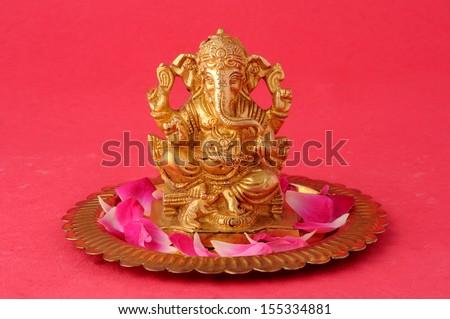 Hindu God Ganesh isolated on rad background - stock photo