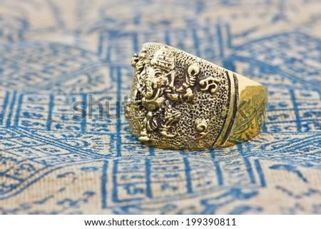 Hindu God Ganesh ring Statue on background - stock photo
