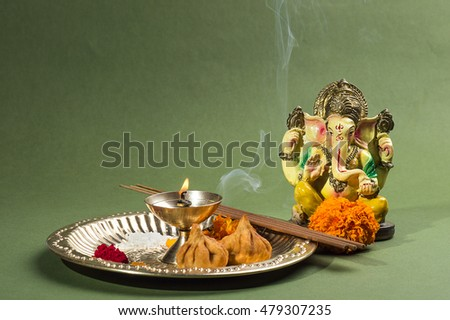 Hindu God Ganesha. Statue of Lord Ganesha. Pooja (Worship) arrangement.