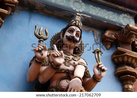 Hindu God Statue with carvings on it - stock photo