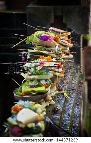 Hindu Offerings at a Temple in Ubud, Bali. Offerings are called banten in Balinese. It is possible that the word comes from the Sanskrit word bali, which means tribute, obligation or gift. - stock photo