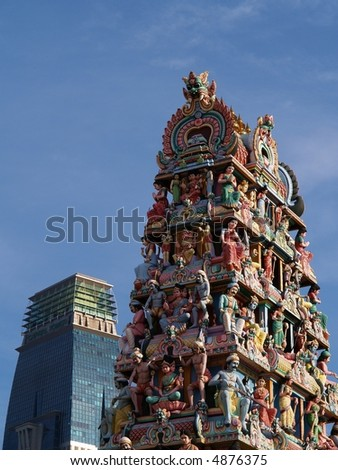 Hindu Statue Temple compared to modern architecture in the background