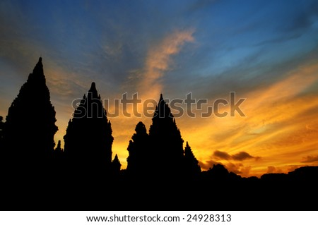 Hindu temple - Dramatic sky with sun setting at Hindu temple Prambanan. Indonesia, Central Java, Yogyakarta - stock photo