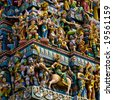 hindu temple in singapore crowded with statues - stock photo