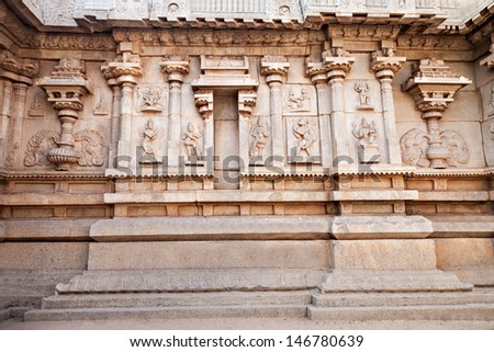 Hindu temple wall with ornate carving, Asia