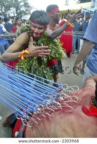 Hindu Thaipusam celebrations at 272-step Batu Caves temple, 2003. - stock photo