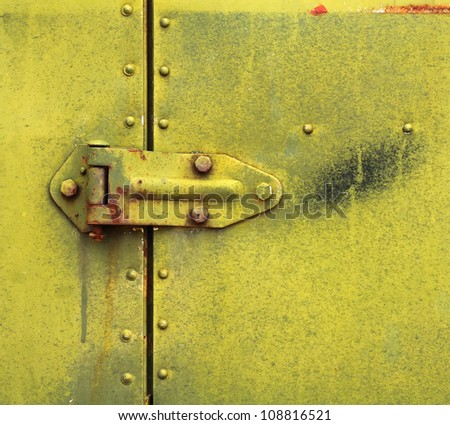 Hinge on Old Rusty Metal Door
