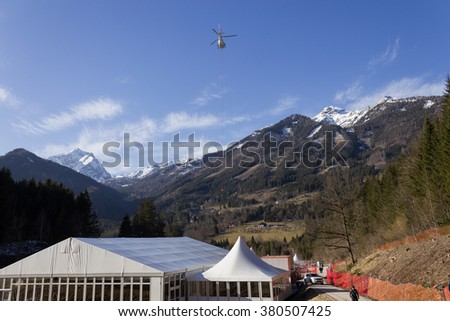 HINTERSTODER- AUSTRIA  February 22, 2016: Ski Worldcup Hinterstoder , the preparations to go to the end, and the helicopter bringing the equipment to the mountain.