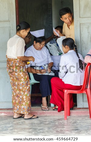 HINTHADA, MYANMAR - AUG 29:  Burmese nurse assists Thai Military Medical Team during Humanitarian assistance at Htanpingone Health care center on Aug 29, 2015 in Hinthada, Myanmar.