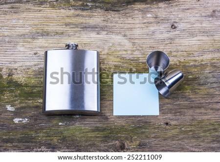 Hip flask on desk - stock photo