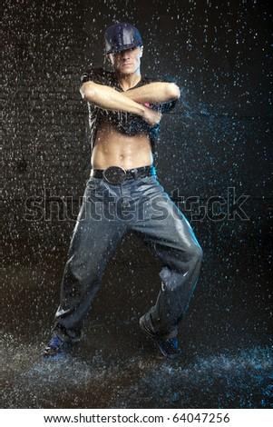 Hip-hop dancer in aqua studio - stock photo