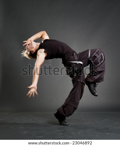 hip-hop guy showing cool motion against dark background